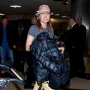 Lucy Lawless is all smiles as she arrives at LAX (Los Angeles International Airport) - 454 x 649