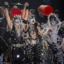 Eric Singer, Paul Stanley and Tommy Thayer of the band KISS participates in the ALS Ice Bucket Challenge at Klipsch Music Center on August 22, 2014 in Noblesville, Indiana