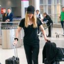 Ellie Goulding seen arriving on a flight at Miami International Airport
