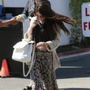 Selena Gomez stops for lunch at Kabuki with a friend on June 10, 2013 in Encino, California - 454 x 646