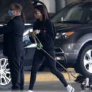 Nina Dobrev – With her pup arrives into Vancouver airport - 454 x 363
