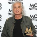 Jimmy Page of Led Zeppelin poses with 'The MOJO Best Live Act' award at The Mojo Honours List 2008 Award Ceremony at The Brewery on June 16, 2008 in London, England - 426 x 594