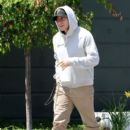 Jake Gyllenhaal tries to hide under his hoodie after having lunch at Tavern restaurant in Brentwood. April 22, 2011