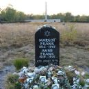 Memorial for Margot and Anne Frank at the former Bergen-Belsen site, along with floral and pictorial tributes - 450 x 600