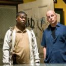 (L-r) TRACY MORGAN as Paul and BRUCE WILLIS as Jimmy in Warner Bros. Pictures' crime comedy 'Cop Out.' Photo by Abbot Genser