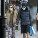 Suki Waterhouse and Robert Pattinson – Wearing matching face masks in London
