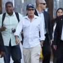 Charlie Sheen greeting fans after taping