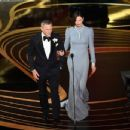 Charlize Theron and Daniel Craig At The 91st Annual Academy Awards - Show - 454 x 347