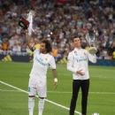 Cristiano Ronaldo and Marcelo of Real Madrid CF hold up the UEFA Super Cup (right) and LaLiga title for 2016/2017 before the La Liga match between Real Madrid CF and Valencia CF at Estadio Santiago Bernabeu on August 27, 2017 in Madrid, Spain - 454 x 510