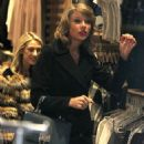 Taylor Swift dons a black wool jacket while doing some shopping with a gal pal on Friday (January 16) in New York City's SoHo district