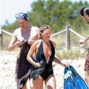 Kate Moss – In black bikini on the beach in Formentera