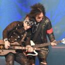Nikki Sixx and DJ Ashba of Sixx:A.M. perform at The Joint inside the Hard Rock Hotel & Casino on April 10, 2015 in Las Vegas, Nevada - 454 x 339
