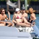 Gigi Hadid in Maroon Bikini on a yacht in Miami