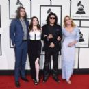Nick Simmons, Sophie Simmons, musician Gene Simmons, and actress Shannon Tweed attend The 58th GRAMMY Awards at Staples Center on February 15, 2016 in Los Angeles, California. - 454 x 302