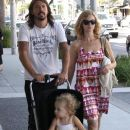 Dave Grohl and his wife Jordyn Blum take their daughter Violet out shopping in Beverly Hills...