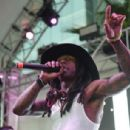Rapper Lil' Wayne performs at Foxtail Pool at SLS Las Vegas on September 6, 2015 in Las Vegas, Nevada - 454 x 306