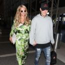 Paris Hilton and Chris Zylka are seen at LAX.NON EXCLUSIVE June 08, 2018 - 454 x 582