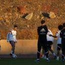 Cristiano Ronaldo of Real Madrid enjoys a joke with his team mates during a training session at Le Grande Satde de Marrakech on December 19, 2014 in Marrakech, Morocco