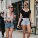 Hailey Clauson walks with a friend in the East Village in New York City, New York on August 5, 2016
