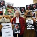 Brian May leads an anti-fox hunting rally for PETA on July 14, 2015 in London, England. - 454 x 303