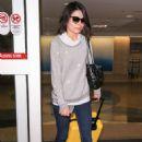 Miranda Cosgrove at Los Angeles International Airport in LA - 454 x 681