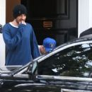 Justin Bieber ducks his head as he leaves a book store in Beverly Hills, California on January 17, 2015