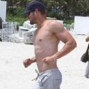 Kellan Lutz enjoying a day on the beach with friends in Miami, Florida on July 10, 2012