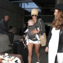 Nina Dobrev in Shorts Arriving at LAX Airport in LA
