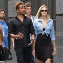 Gary Dourdan and an unidentified blonde woman are spotted walking around Manhattan's Soho neighborhood on September 2, 2016 - 405 x 600