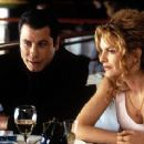 John Travolta and Rene Russo