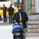 Irina Shayk with her daughter seen around her neighborhood in New York