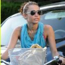 Miley Cyrus Out Riding Her Bike With Some Friends While Her Dad Billy Ray Cyrus Takes The Dog For A Walk In Toluca Lake, 2008-08-05