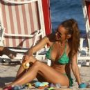 Annemarie Carpendale in Green Bikini at the beach in Miami - 454 x 496