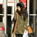 Vanessa Hudgens & Austin Butler bundles up from the cold weather while picking up some boxes at a local UPS store on Saturday afternoon (November 30) in New York City