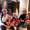Cristiano Ronaldo and his fiancée Georgina Rodriguez don Santa hats as they dress the kids up in full costume for rare festive family snap - 454 x 341