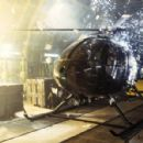 Sparks rain down on a helicopter while the cargo plane carrying it disintegrates in MGM's Die Another Day - 2002