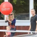 Reese Witherspoon at the Brentwood Country Market with her hubby and their son Tennessee in Brent wood, California on December 10, 2016 - 454 x 330
