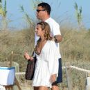 Retired footballer Ronaldo uses a selfie stick to take loved up holiday snaps in the sea with beach babe fiancé Paula Morais