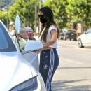 Olivia Munn – Looks sporty wearing Addidas while leaving a nail salon in Studio City - 454 x 639
