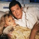 Roger Moore and Mary Stavin