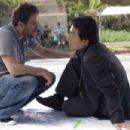 Director Brett Ratner and Jackie Chan review a scene on the set of New Line Cinema's action comedy RUSH HOUR 3. Photo Credit: ©2007 Glen Wilson/New Line Cinema