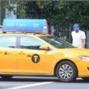Leonardo DiCaprio Hails A Cab In New York - June 30, 2016