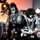 Musicians Gene Simmons  and Tommy Thayer of KISS perform onstage during the 23rd Annual Race To Erase MS Gala at The Beverly Hilton Hotel on April 15, 2016 in Beverly Hills, California. - 454 x 328