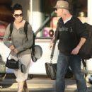 Corey Taylor and Stephanie Luby arrive at Perth Airport in Australia.