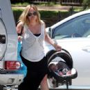Hilary Duff and son Luca Comrie head to a baby shower for a friend in Beverly Hills, CA on July 21st, 2012