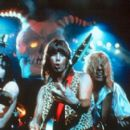 Bass player Derek Smalls (Harry Shearer), co-lead guitarist Nigel Tufnel (Christopher Guest) and lead singer/co-lead guitarist David St. Hubbins (Michael McKean) are Spinal Tap in This Is Spinal Tap - 1984, re-released by MGM in 2000 - 400 x 265