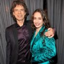 L'Wren Scott and Mick Jagger attends The 53rd Annual GRAMMY Awards held at Staples Center on February 13, 2011 in Los Angeles, California - 426 x 594