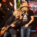Bret Michaels performs with the cast of