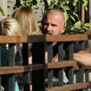 Actor Dominic Purcell cozies up to a mystery girl after enjoying lunch with her at Granville in Studio City, California on January 14, 2015