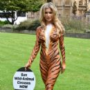 Joanna Krupa – Bodypaint while protesting outside Westminster in London - 454 x 718